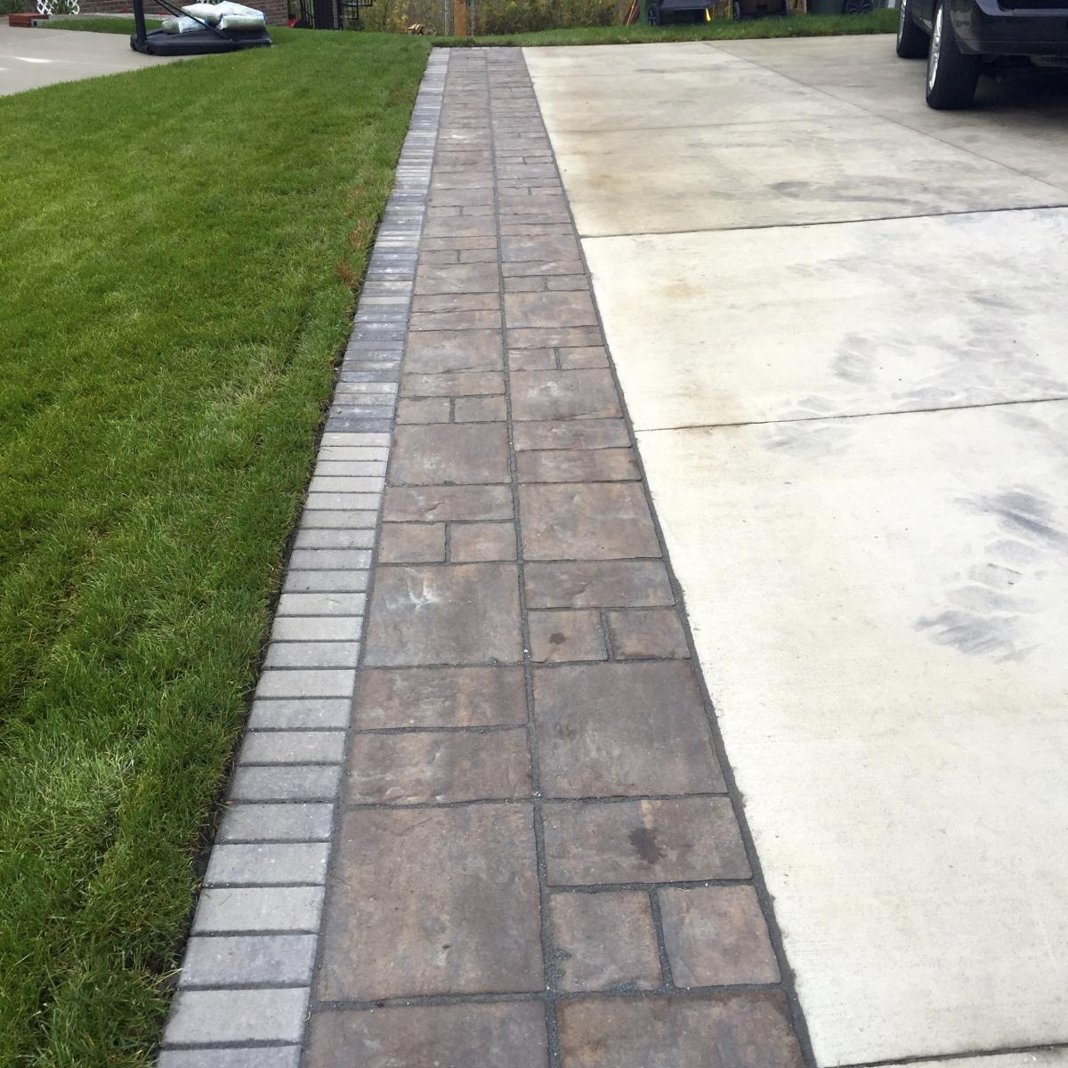 A beautiful look to the entryway of your home brick driveways enhance the look of the houses where they are installed